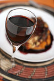 Red Wine Dinner; Glass Focused Tall View. Royalty Free Stock Photos