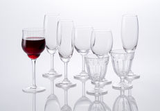 Red wine and empty glasses Royalty Free Stock Images