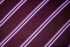 Red wine fabric texture. A close up of a Red wine with white, black and lilac lines stitching Stock Image