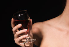 Red wine in a female hand Royalty Free Stock Photography