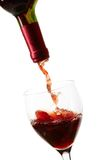 Red wine filling a glass Royalty Free Stock Images