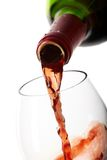Red wine filling a glass Royalty Free Stock Photography
