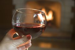 Red Wine by the Fire Stock Image