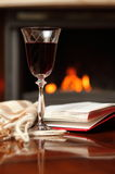 Red wine by the fireplace Royalty Free Stock Images