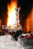 Red wine at the fireplace. Drinking red wine at the fireplace stock photography