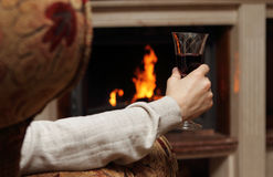 Red wine by the fireplace Stock Photos