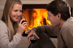 Red wine by fireplace Royalty Free Stock Image