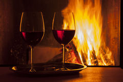 Red wine at fireplace Royalty Free Stock Photo