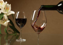Red wine and flowers Stock Images