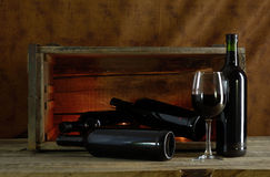 Red wine. Four bottles and a glass of red wine stock photos