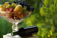 Red wine with fruit basket royalty free stock image