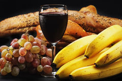 Red wine with fruits and pastry Stock Images