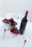 Red wine and fruits on a table Royalty Free Stock Photos