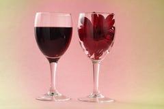 Red wine and gerbera Stock Photos
