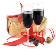 Red wine,gift, red ribbon  and  chocolates Royalty Free Stock Photos