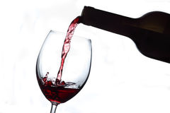 Red wine glas and bottle Stock Image