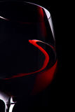 Red wine glass. In black background Stock Image