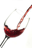 Red wine into glass. Dynamic action, poured red wine into glass Stock Photography