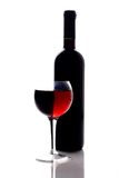 Red wine glass. And wine bottle royalty free stock images
