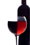 Red wine glass. And wine bottle Royalty Free Stock Image