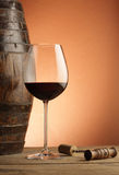 Red wine glass. Woodden barrel and corkscrew stock photo