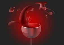 Red wine in the glass. On black background Royalty Free Stock Photos