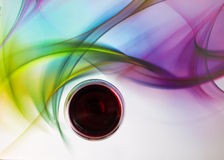 Red Wine Glass. Abstract glassware background design of wine glass and grapes on multicolored background stock image
