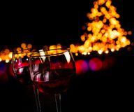 Red wine glass against bokeh lights background Stock Images