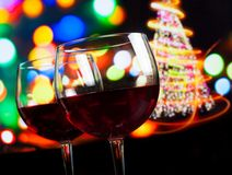 Red wine glass against bokeh lights tree background Royalty Free Stock Images