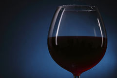 Red wine glass on the background. Red wine glass on the blue background Royalty Free Stock Photography