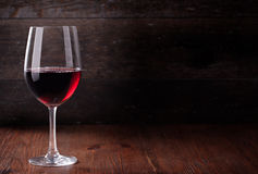 Red wine. Wine glass on the background of the bar Stock Photos