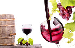 Red wine, glass and barrel with grapes Stock Image
