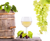 Red wine, glass and barrel with grapes Stock Photos