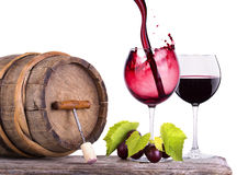 Red wine, glass and barrel with grapes Royalty Free Stock Photos