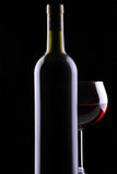 Red Wine Glass in Behind Bottle Royalty Free Stock Images