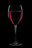 Red wine in glass on black Stock Image
