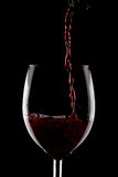 Red wine glass on black. Studio shot Royalty Free Stock Photos