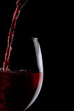 Red wine glass on black Stock Image