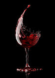 Red wine glass on black background Stock Photo