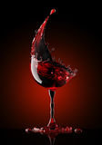 Red wine glass on black background. Red wine glass on a isolated black background. 3d rendering Royalty Free Stock Image