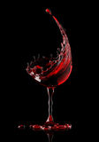 Red wine glass on black background Royalty Free Stock Photography