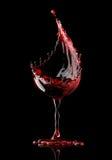Red wine glass on black background stock illustration