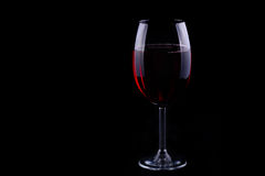 Red wine glass on the black background Stock Photography