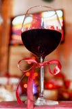 Red wine glass on a bokeh background Stock Images