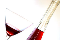 Red Wine in a Glass and Bottle Stock Photo