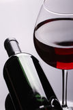 Red Wine glass and Bottle Stock Image