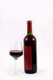 Red wine glass and bottle. Isolated on white , clipping path for the label Stock Photo