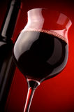 Red wine glass and bottle Stock Photos