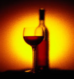 Red wine glass and bottle Royalty Free Stock Images