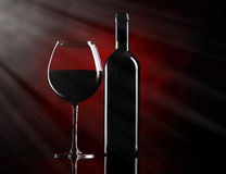 Red wine glass with bottle Stock Photos